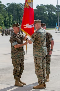 U.S. Marine Corps Sgt. Maj. Jeffrey G. Chamberlain, 2nd Intelligence Battalion, II Marine Expeditionary Force Information Group, delivers the unit colors during a change of command ceremony for 2nd Intelligence Battalion at Camp Lejeune, N.C., June 25, 2018. Lt. Col. Brian S. Albon relinquished command to Lt. Col. Wyeth Towle. (U.S. Marine Corps photo by Lance Cpl. Caleb T. Maher)