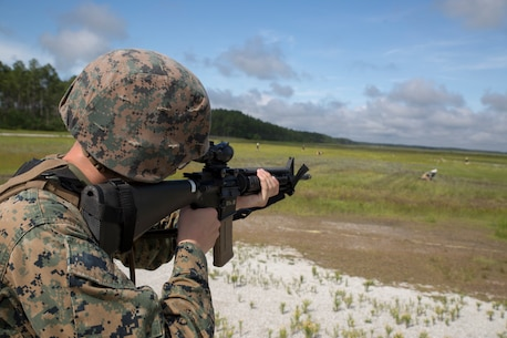 U.S. Marine Corps PFC. Tristin R. Greg with 2nd Law Enforcement Battalion, II Marine Expeditionary Force Information Group, participates in a live-fire range, testing a new autonomous robotic target system at Camp Lejeune, N.C., June 27, 2018. These targets will help to further develop Marines marksmanship skills, anticipate natural movement and increase combat effectiveness. (U.S. Marine Corps photo by Lance Cpl. Caleb T. Maher)