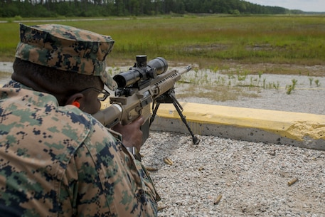 U.S. Marine Corps 2nd Lt. Ade Mubarak with 2nd Law Enforcement Battalion, II Marine Expeditionary Force Information Group, participates in a live-fire range to test a new autonomous robotic target system at Camp Lejeune, N.C., June 27, 2018. These targets will help to further develop Marines marksmanship skills, anticipate natural movement and increase combat effectiveness. (U.S. Marine Corps photo by Lance Cpl. Caleb T. Maher)