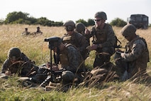 U.S. Marines with 2nd Air Naval Gunfire Liaison Company assist forward observer teams from the British Royal Army while conducting live-fire missions as part of Exercise Green Cannon 18 at Salisbury Plains, United Kingdom, July 4, 2018. Green Cannon is an annual live-fire exercise between the United States Marine Corps, allied and partner nations in order to increase interoperability in the region. (U.S. Marine Corps photo by Cpl. David Delgadillo)