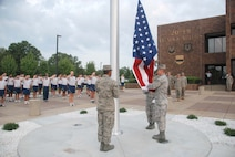 U.S. Airmen assigned to the 20th Force Support Squadron Honor Guard raise a flag for the first time on the new 20th Fighter Wing (FW) flagpole during a reveille ceremony at Shaw Air Force Base, S.C., Aug. 15, 2008.