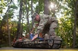 Sgt. 1st Class Paul Shelton, an instructor with the 104th Training Division, double checks the equipment of a basket stretcher before cadets utilize it during the Field Leaders Reaction Course at Fort Knox, Kentucky, July 11, 2018. U.S. Army Reserve Soldiers, with the 104th Training Division, led events at the U.S. Army's Basic Camp in order to develop and reinforce Army values in cadets. (U.S. Army photo by Staff Sgt. Dalton Smith)