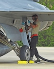 U.S. Air Force Senior Airman Jacob Leighton, 20th Aircraft Maintenance Squadron aircraft maintainer, begins refueling an F-16CM Fighting Falcon at Shaw Air Force Base, S.C., June 26, 2018.