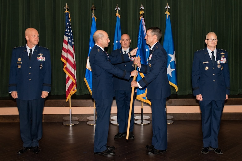 Gen. Mike Holmes, commander of Air Combat Command, presents the 24th Air Force guidon to Maj. Gen. Robert Skinner upon assuming command of the 24th AF during a ceremony at Joint Base San Antonio-Lackland, Texas, July 17, 2018. Twenty Fourth Air Force was reassigned to a new major command and welcomed Skinner during the ceremony. (U.S. Air Force photo by Andrew C. Patterson)