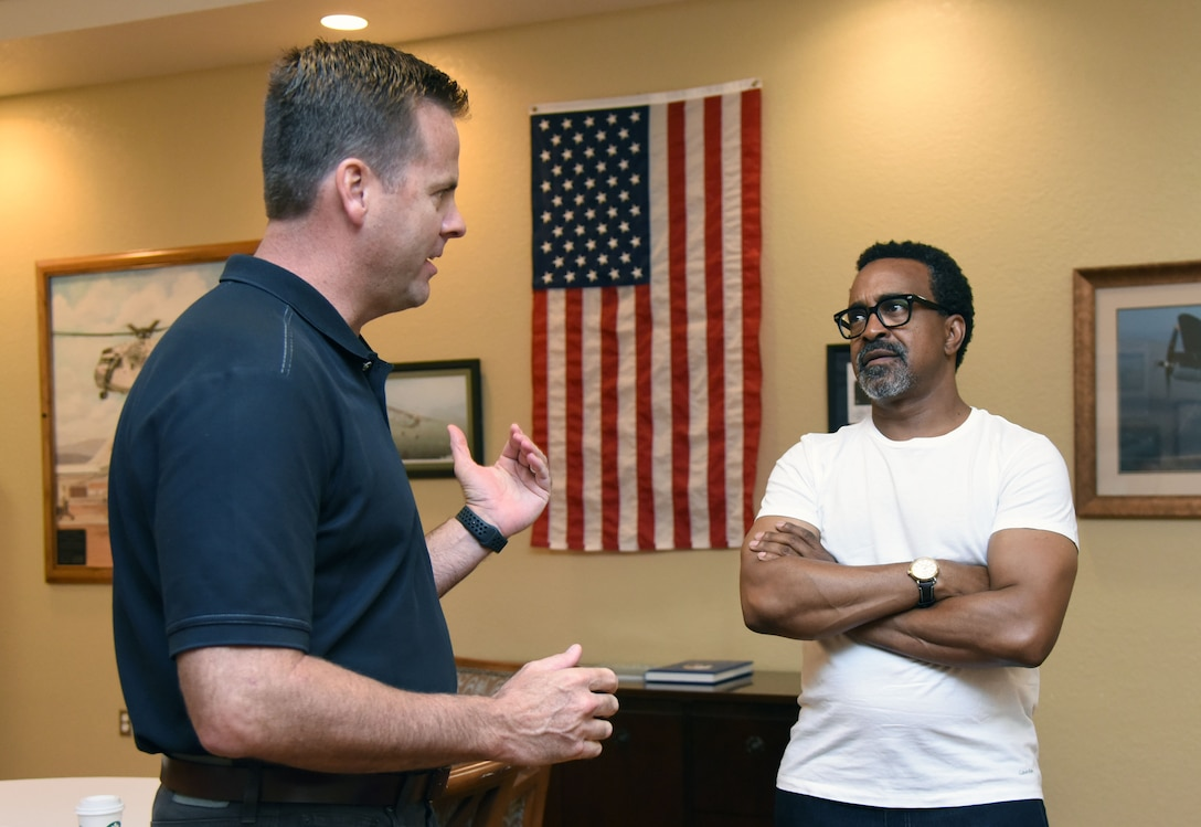 U.S. Air Force Col. Lance Burnett, 81st Training Wing vice commander, welcomes Tim Meadows, actor and comedian, prior to a performance at the Bay Breeze Event Center at Keesler Air Force Base, Mississippi, July 14, 2018. Meadows is also an alumni of the late-night comedy show, Saturday Night Live. (U.S. Air Force photo by Kemberly Groue)