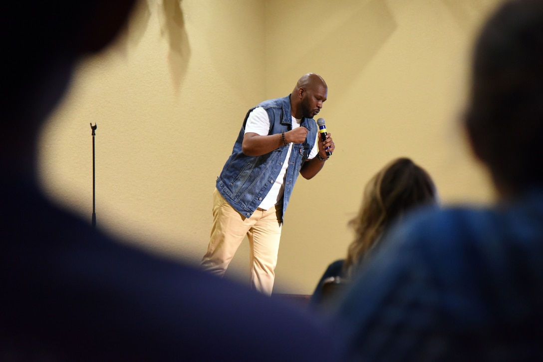 Walter Campbell, comedian, performs for Keesler personnel at the Bay Breeze Event Center at Keesler Air Force Base, Mississippi, July 14, 2018. Campbell was a featured act for Tim Meadows, actor and comedian, who is also an alumni of the late-night comedy show, Saturday Night Live. (U.S. Air Force photo by Kemberly Groue)