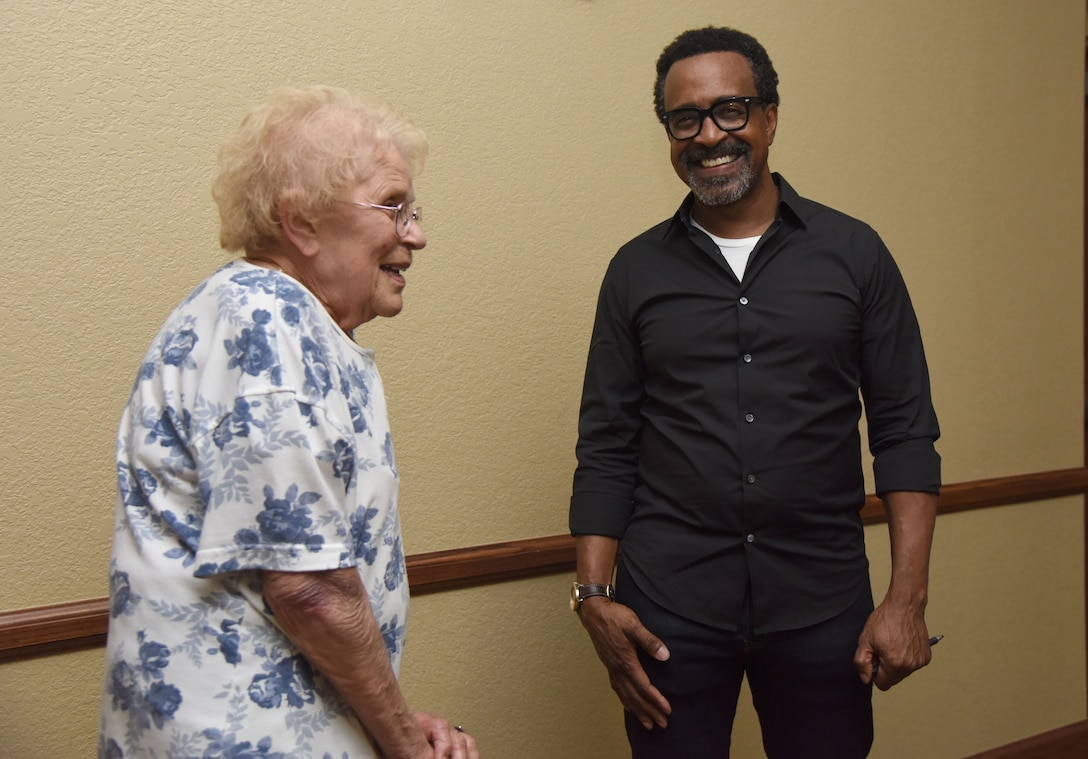 U.S. Air Force retired Col. Phyllis Luttman meets Tim Meadows, actor and comedian, following his performance at the Bay Breeze Event Center at Keesler Air Force Base, Mississippi, July 14, 2018. Meadows is also an alumni of the late-night comedy show, Saturday Night Live. (U.S. Air Force photo by Kemberly Groue)