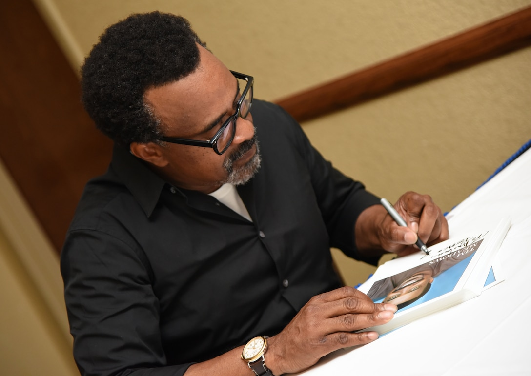 Tim Meadows, actor and comedian, signs autographs for Keesler personnel following a performance at the Bay Breeze Event Center at Keesler Air Force Base, Mississippi, July 14, 2018. Meadows is also an alumni of the late-night comedy show, Saturday Night Live. (U.S. Air Force photo by Kemberly Groue)