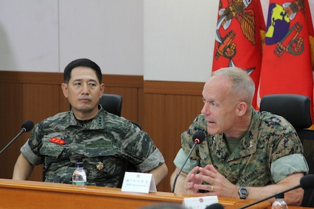 BARAN-RI, South Korea – Maj. Gen. Patrick J. Hermesmann (right), commander of U.S. Marine Corps Forces Korea, and Lt. Gen. Jun, Jin Goo, commandant of the Republic of Korea Marine Corps, speak to their staff here, July 3. The ROKMC and UMSC signed an agreement that strengthened their services' relationship and interoperability. (Official U.S. Marine Corps photo by Staff Sgt. Anthony Kirby/Released)