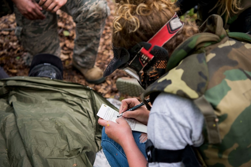 U.S. Air Force 2nd Lt. Shelby Landfair, registered nurse assigned to the 673d Inpatient Operations Squadron, fills out a DD form 1380, Tactical Combat Casualty Care medical card, during the practical application of the TCCC course at the Warrior Extreme Paintball course at Joint Base Elmendorf-Richardson, Alaska, July 13, 2018. The course is an opportunity for every student to provide care under fire, perform tactical field care on those who are injured and execute a tactical evacuation.