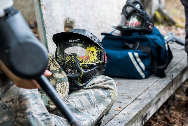 A Tactical Combat Casualty Care instructor waits for 673d Medical Group personnel to prepare for the practical application of the TCCC course at the Warrior Extreme Paintball course at Joint Base Elmendorf-Richardson, Alaska, July 13, 2018. The course is an opportunity for every student to provide care under fire, perform tactical field care on those who are injured and execute a tactical evacuation.