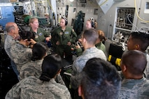 U.S. Air Force Master Sgt. Michelle Geers, an aeromedical evacuation technician from the 315th Aeromedical Evacuation Squadron, discusses various types of life-saving equipment used aboard a U.S. Air Force C-17 Globemaster III aircraft with 624th Aeromedical Staging Squadron personnel at U.S. Coast Guard Air Station Barbers Point, Hawaii, July 10, 2018, during Pacific Lifeline 2018.