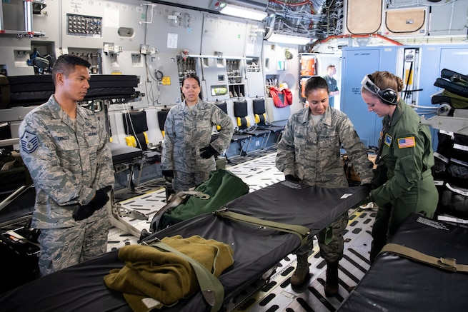 U.S. Air Force Staff Sgt. Jodi Signer, an instructor from the 446th Aeromedical Evacuation Squadron, familiarizes 624th Aeromedical Staging Squadron personnel with patient equipment aboard a U.S. Air Force C-17 Globemaster III aircraft at U.S. Coast Guard Air Station Barbers Point, Hawaii, July 10, 2018, during Pacific Lifeline 2018.