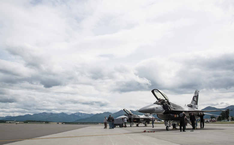 U.S. Air Force Pacific Air Forces' F-16 Demonstration Team and contractors perpare two F-16 Fighting Falcons from Eielson Air Force Base, Alaska, for an aerobatic practice at Joint Base Elmendorf-Richardson, Alaska, June 26, 2018. Eielson AFB supported the demo team by providing aircraft to fly as well as contractors to maintain the jets for the 2018 Arctic Thunder biennial air show . (U.S. Air Force photo by Senior Airman Sadie Colbert)