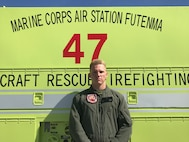 Sgt. Cody Harbst poses for a photo July 16 at Ie Shima Training Facility.