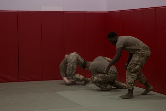 CAMP FOSTER, OKINAWA, Japan – U.S. Army soldiers preforms the forward roll during Marine Corps Martial Arts Program training June 28 at Gunner's Gym aboard Camp Foster, Okinawa, Japan.
