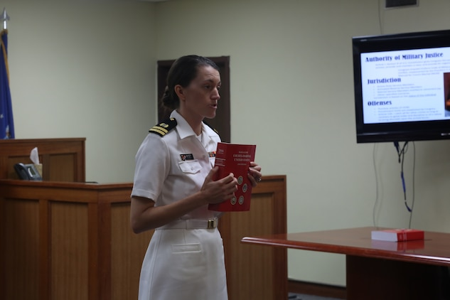KADENA AIR BASE, OKINAWA, Japan – U.S. Navy Lt. Rachael Baker explains Uniformed Code of Military Justice concepts during a mock trial June 29 on Kadena Air Base, Okinawa, Japan.