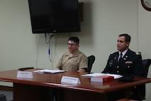 KADENA AIR BASE, OKINAWA, Japan – U.S. Marine Lance Cpl. Irvin Guzmanescalera, left, and U.S. Air Force Capt. Juan Mejia serve as the accused and defense council during a mock trial June 29 on Kadena Air Base, Okinawa, Japan.