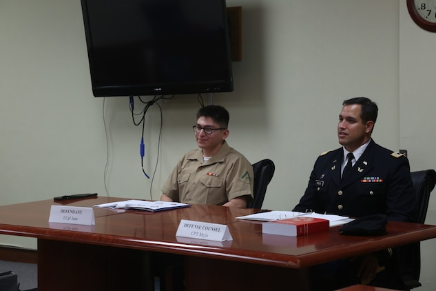 KADENA AIR BASE, OKINAWA, Japan – U.S. Marine Lance Cpl. Irvin Guzmanescalera, left, and U.S. Air Force Capt. Juan Mejia serve as the accused and defense council during a mock trial June 29 on Kadena Air Base, Okinawa, Japan.