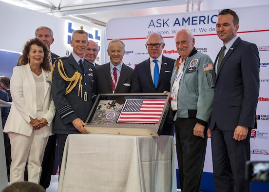 U.S. and U.K. guests of honor pose for a photo following the opening ceremony of the Farnborough International Airshow July 16, 2018. The ceremony featured an Apollo 15 flag presentation to the Royal Air Force Chief of Staff, Air Chief Marshal Sir Stephen Hillier, to commemorate their RAF centennial celebration. U.S. guests of honor included: the Honorable Robert Wood Johnson, U.S. Ambassador to the U.K., 22nd Secretary of the Army Eric Fanning, and Retired Col. Al Woden, Command Module Pilot for the Apollo 15 lunar mission in 1971. (U.S. Navy photo by MC2 Cody Hendrix)