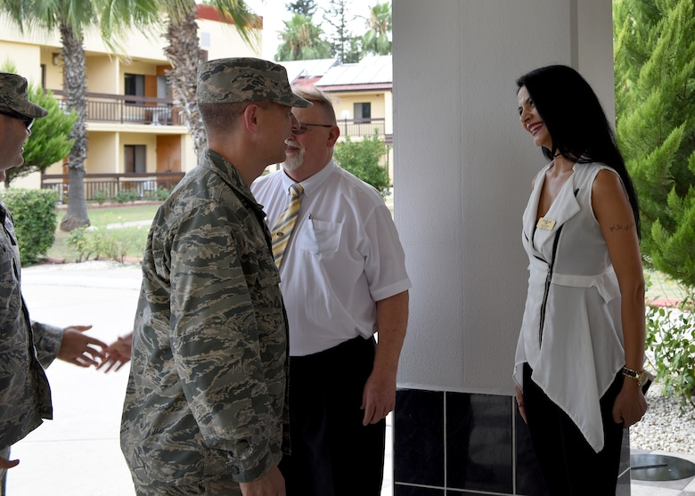 U.S. Air Force Col. Britt Hurst, 39th Air Base Wing commander, congratulates Nazan Ogru, Hodja Inn quality assurance trainer, as she is one of the top four nominees for the 2018 Air Force Innkeeper Travelers' Award in the Large Category lodging operations at Incirlik Air Base, Turkey, July 18, 2018.