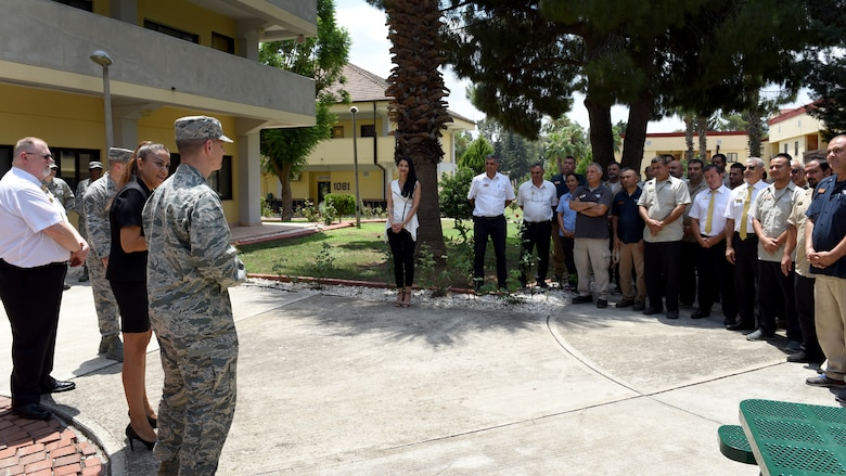 U.S. Air Force Col. Britt Hurst, 39th Air Base Wing commander, congratulates 39th FSS lodging team for winning the 2018 Air Force Innkeeper Award, Large Category for lodging operations at Incirlik Air Base, Turkey, July 18, 2018.