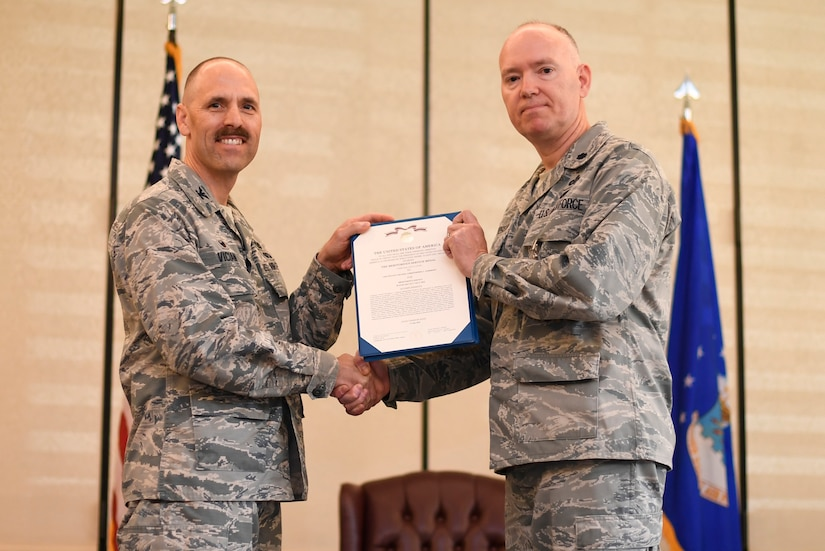 Col. Todd M. Vician, left, Air Force Public Affairs Agency commander, awards the Meritorious Service Medal to Lt. Col. Christopher A. Anderson, outgoing commander of the 1st Combat Camera Squadron, during a change of command ceremony July 17, 2018, at Joint Base Charleston, S.C
