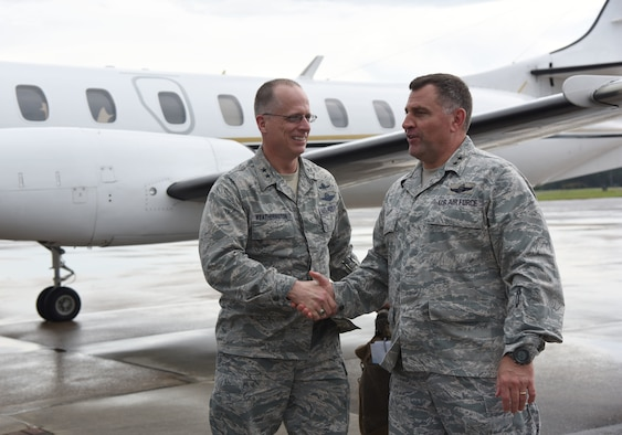 U.S. Air Force Maj. Gen. Timothy Leahy, 2nd Air Force commander, greets Maj. Gen. Mark Weatherington, Air Education and Training Command deputy commander, on the flightline at Keesler Air Force Base, Mississippi, July 11, 2018. Weatherington had a one-day site visit at Keesler to become more familiar with the base's mission. He received 81st Training Wing and 81st Training Group mission briefings followed by a windshield tour of the base. (U.S. Air Force photo by Kemberly Groue)