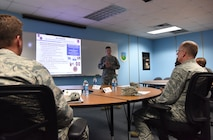 U.S. Air Force Lt. Col. Nathaniel Huston, 333rd Training Squadron commander, explains how 81st Training Group squadrons are implementing Continuum of Learning strategies into the classrooms to Maj. Gen. Mark Weatherington, Air Education and Training Command deputy commander, during a site visit at Bryan Hall on Keesler Air Force Base, Mississippi, July 11, 2018. Weatherington had a one-day site visit at Keesler to become more familiar with the base's mission. He also received 81st Training Wing and 81st TRG mission briefings followed by a windshield tour of the base. (U.S. Air Force photo by Kemberly Groue)