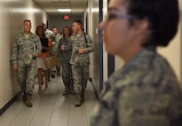 U.S. Air Force Tech. Sgt. Zachary Bartlett, 81st Training Support Squadron military training leader, provides a tour of the Levitow Training Support Facility to Lt. Gen. Steven Kwast, Air Education and Training Command commander, during an immersion tour at Keesler Air Force Base, Mississippi, July 16, 2018. Kwast also received a tour of Cody Hall and the Keesler Medical Center to become more familiar with Keesler's mission. (U.S. Air Force photo by Kemberly Groue)