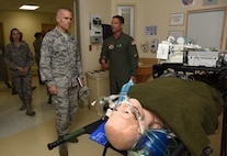 U.S. Air Force Capt. Roger West, 81st Inpatient Operation Squadron intensive care unit element leader, briefs Lt. Gen. Steven Kwast, Air Education and Training Command commander, on ICU care at the Keesler Medical Center during an immersion tour at Keesler Air Force Base, Mississippi, July 16, 2018. Kwast also received an 81st Training Group briefing and a tour of the Levitow Training Support Facility to become more familiar with Keesler's mission. (U.S. Air Force photo by Kemberly Groue)