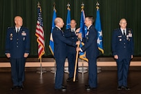 Gen. Mike Holmes, commander of Air Combat Command, presents the 24th Air Force guidon to Maj. Gen. Robert Skinner, who assumed command of the 24th Air Force during a ceremony at Joint Base San Antonio-Lackland July 17. Twenty Fourth Air Force was reassigned to a new major command and welcomed Skinner during the ceremony.