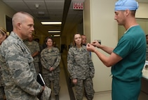 U.S. Air Force Maj. F. David Russo, 81st Medical Operations Squadron interventional cardiologist, briefs Lt. Gen. Steven Kwast, Air Education and Training Command commander, and Chief Master Sgt. Julie Gudgel, AETC command chief, on implant procedures at Keesler Medical Center during an immersion tour at Keesler Air Force Base, Mississippi, July 16, 2018. Kwast also received an 81st Training Group briefing and a tour of the Levitow Training Support Facility to become more familiar with Keesler's mission. (U.S. Air Force photo by Kemberly Groue)