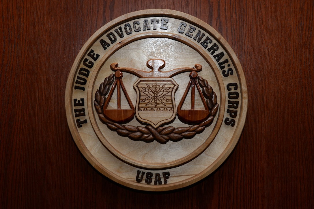 The seal of the Judge Advocate General Corps is displayed inside the 28th Bomb Wing courtroom at Ellsworth Air Force Base, S.D., July 17, 2018. The Ellsworth Judge Advocate office serves as the legal advisor for the 28th Bomb Wing. They handle issues including administrative law, government contracting and military law. (U.S. Air Force photo by Airman 1st Class Nicolas Z. Erwin)