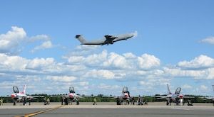 A Westover C-5M Super Galaxy flies over the Thunderbirds July 12, 2018, at Westover ARB. The Thunderbirds highlighted the Great New England Air and Space Show July 14th and 15th
