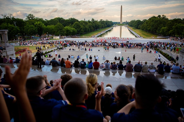 Students with the Summer Leadership and Character Development Academy applaud during The Commandant's Own Drum and Bugle Corps' performance at the Lincoln Memorial in the District of Columbia, July 17, 2018. Students accepted into the academy were hand-selected by a board of Marines who look to find attendees with similar character traits as Marines. Inspired by the Marine Corps' third promise of developing quality citizens, the program was designed to challenge and develop the nation's top-performing high school students so they could return to their communities more confident, selfless and better equipped to improve the lives of those around them. (U.S. Marine Corps photo by Staff Sgt. John A. Martinez Jr.)