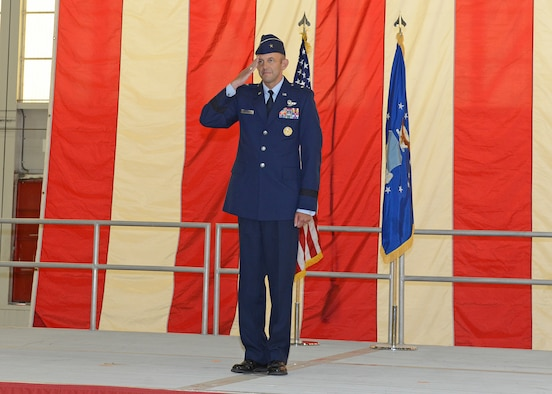 Brig. Gen. E. John Teichert III, gives his first salute to his workforce after assuming command of the 412th Test Wing July 18 in Hangar 1600 at Edwards Air Force Base. (U.S. Air Force photo by Kenji Thuloweit)