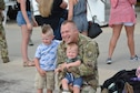 U.S. Air Force Master Sgt. Landon Rother, a KC-135R Stratotanker aircraft avionics technician with the 507th Aircraft Maintenance Squadron at Tinker Air Force Base, Okla., reunites with his family following a deployment July 5, 2018. More than 100 Reserve Citizen Airmen from the 507th Air Refueling Wing at Tinker AFB deployed to Incirlik Air Base, Turkey, in support of air operations. (U.S. Air Force photo by Tech. Sgt. Samantha Mathison)