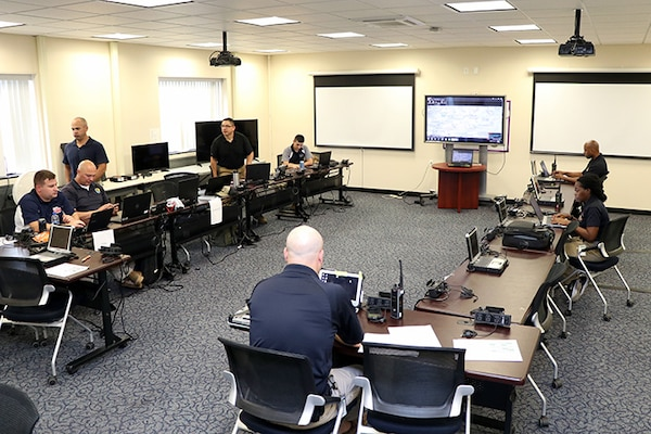 Members of the District of Columbia National Guard's 33rd Civil Support Team and Delaware's 31st CST, man the joint operations center on July 17, 2018, at the D.C. Armory in Washington, D.C. The JOC was the center for operations during the 33rd and 31st CSTs mobilization for the 2018 MLB All-Star Game at Nationals Park. (screens have been blurred)