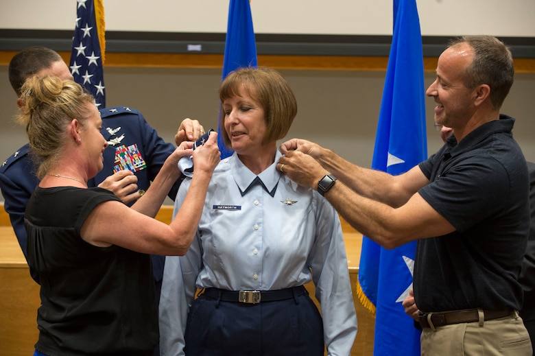 Melissa Swarbrick and Robert Smith place brigadier general rank insignia on their sister, Col. Michelle Hayworth, Air Forces Cyber vice commander, during her promotion ceremony at Joint Base San Antonio-Lackland, Texas, July, 16, 2018. In June, Hayworth re-joined AFCYBER from Air Force Space Command. She previously served in AFCYBER, most recently as the 688th Cyberspace Wing Commander. (U.S. Air Force photo by Tech. Sgt. R.J. Biermann)