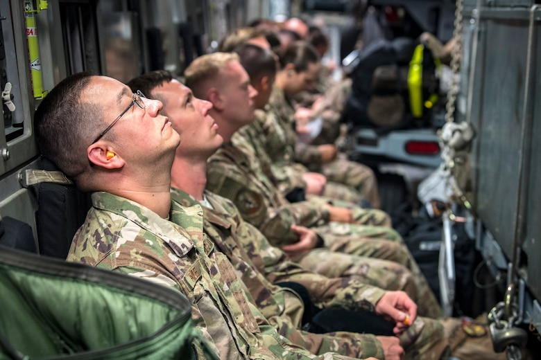 Moody Airmen wait inside a C-17 Globemaster III prior to deploying, July 5, 2018, at Moody Air Force Base, Ga. Airmen from the 75th Fighter Squadron (FS) and supporting units recently deployed to an undisclosed location in support of Operation Spartan Shield. The 75th FS will undertake close air support missions with the A-10C Thunderbolt II while deployed. (U.S. Air Force photo by Airman 1st Class Eugene Oliver)