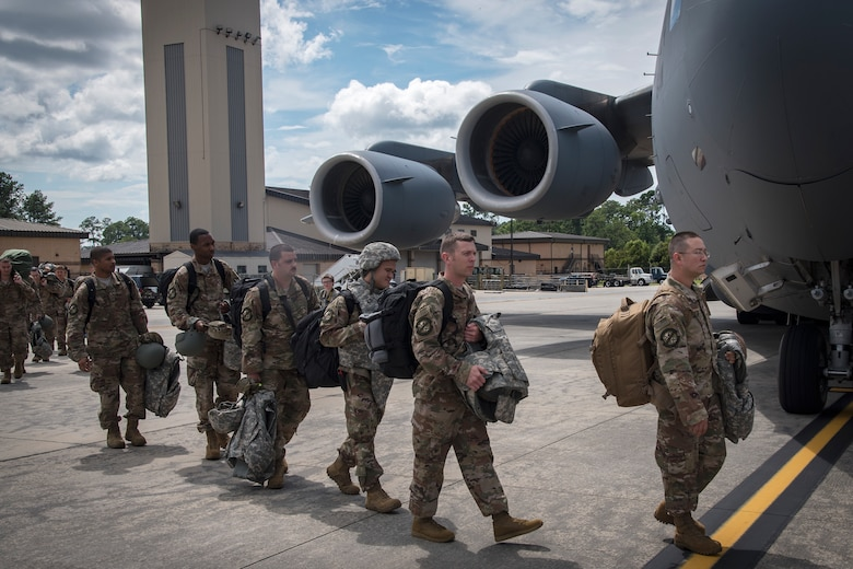 Moody Airmen prepare to board a C-17 Globemaster III prior to deploying, July 5, 2018, at Moody Air Force Base, Ga. Airmen from the 75th Fighter Squadron (FS) and supporting units recently deployed to an undisclosed location in support of Operation Spartan Shield. The 75th FS will undertake close air support missions with the A-10C Thunderbolt II while deployed. (U.S. Air Force photo by Airman 1st Class Eugene Oliver)