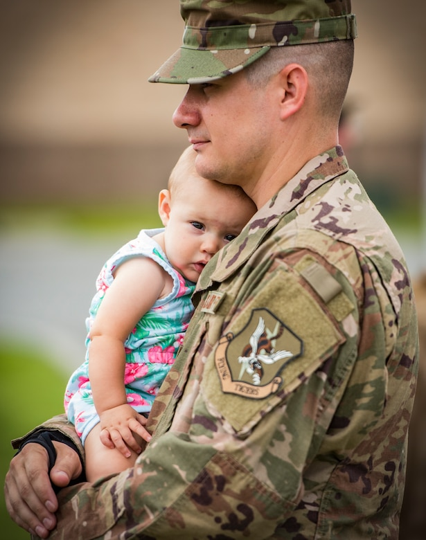 Tech. Sgt. Christopher West, 23d Aircraft Maintenance Squadron weapons expeditor, holds his daughter, Savannah, July 9, 2018, at Moody Air Force Base, Ga. Airmen from the 75th Fighter Squadron (FS) and supporting units deployed to an undisclosed location in support of Operation Spartan Shield. (U.S. Air Force photo by Staff Sgt. Ceaira Tinsley)