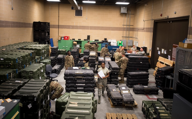 Airmen from the 75th Fighter Squadron (FS) and supporting units gather gear July 8, 2018, at Moody Air Force Base, Ga. The 75th FS and supporting units deployed to an undisclosed location in support of Operation Spartan Shield. (U.S. Air Force photo by Staff Sgt. Ceaira Tinsley)