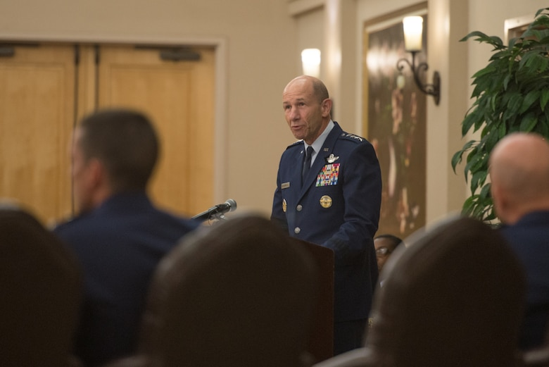 "Gen. Mike Holmes, commander of Air Combat Command, addresses attendees during a command transfer and change of command ceremony at Joint Base San Antonio-Lackland, Texas, July 17, 2018. The command transfer realigned the 24th Air Force cyber operations under ACC alongside 25th AF intelligence, surveillance and reconnaissance missions; all to ""drive faster decisions as we fight,"" said Secretary of the Air Force Heather Wilson, in a June 7 statement. (U.S. Air Force photo by Andrew C. Patterson)"