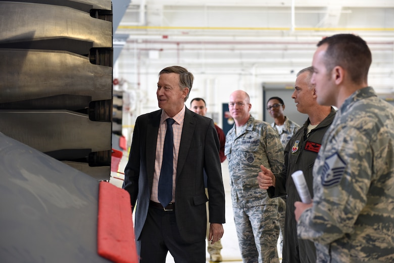 Gov. John Hickenlooper of Colorado, far left, receives a brief on the Colorado Air National Guard's F-16 Falcon's mission capabilities from Col. Brian Turner, second from right, 140th Wing commander, at Buckley Air Force Base, Colorado, July 17, 2018.