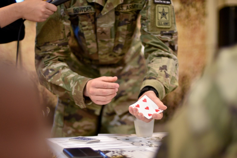 U.S. Army Pvt. Harland Bowden, 344th Military Intelligence Battalion student, performs a magic trick during the semi-annual Goodfellow's Got Talent show at the Crossroads Student Ministry Center on Goodfellow Air Force Base, Texas, July 13, 2018. The students performed their unique skills before their peers and judges. (U.S. Air Force photo by Senior Airman Randall Moose/Released)