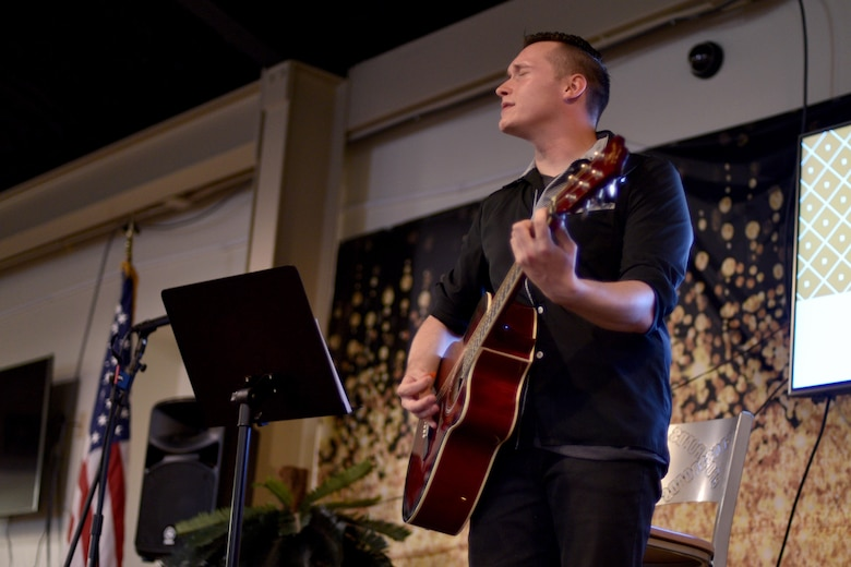 U.S. Army Pvt. Gabriel Augustinowicz, 344th Military Intelligence Battalion student, performs a song during the semi-annual Goodfellow's Got Talent show at the Crossroads Student Ministry Center on Goodfellow Air Force Base, Texas, July 13, 2018. The Crossroads Student Ministry Center provides the students a place to socialize, relax and seek mentorship from the Chaplains. (U.S. Air Force photo by Senior Airman Randall Moose/Released)