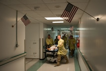 U.S. Airmen assigned to the 455th Expeditionary Medical Group transport an Afghan National Defense and Security Forces soldier who sustained trauma from a gunshot to the operating room at the Craig Joint Theater Hospital, Bagram Air Field, Afghanistan, Sept. 26, 2015. The CJTH provides surgical capabilities in trauma, general surgery, orthopedics, neurosurgery, urology, vascular surgery and otolaryngology, all of which are critical to helping 98 percent of patients who come to the hospital survive their injuries. (U.S. Air Force photo by Tech. Sgt. Joseph Swafford/Released)