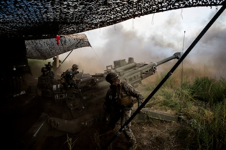 U.S. Marines deliver the boom during RIMPAC